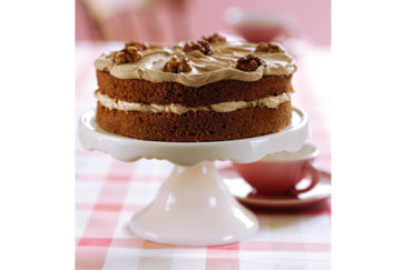 Coffee and walnut cake on a cake stand
