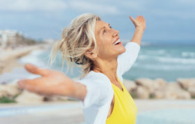 Joyful woman enjoying the freedom of the beach Pic: Istockphoto