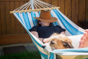 Woman, mongrel dog, hammock, summer, taking a break, vacation, vacation, sun hat, heat, shadow