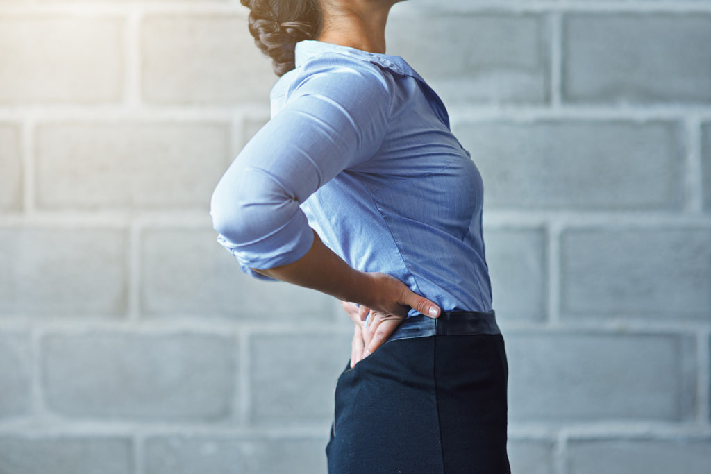 Cropped shot of a businesswoman suffering from back pain