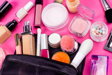 Make-up and brushes spilling out of a cosmetics bag