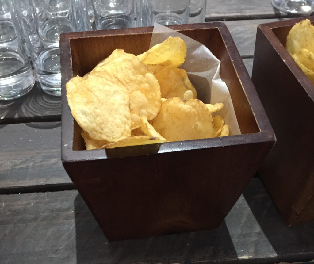 Crisps in a brown bowl