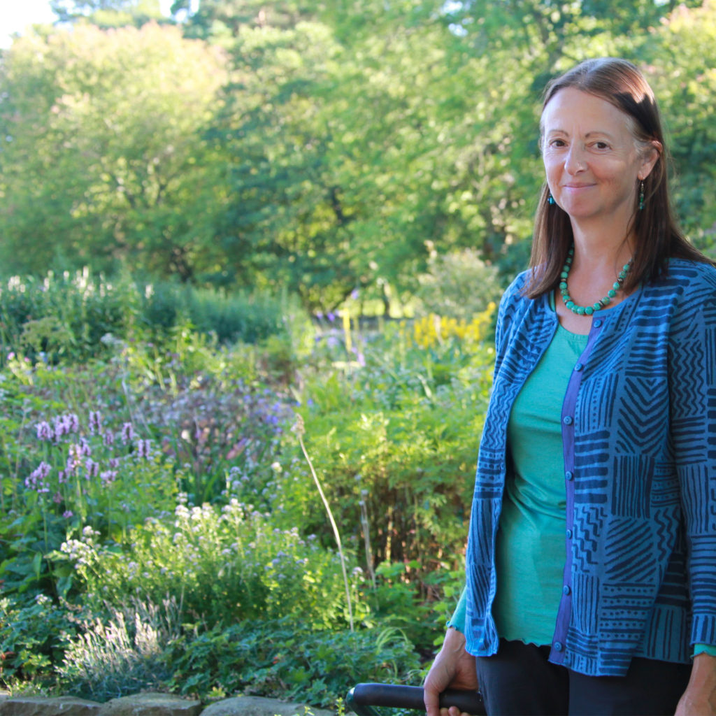 Gardening expert Susie White stands in front of a shady part of her garden