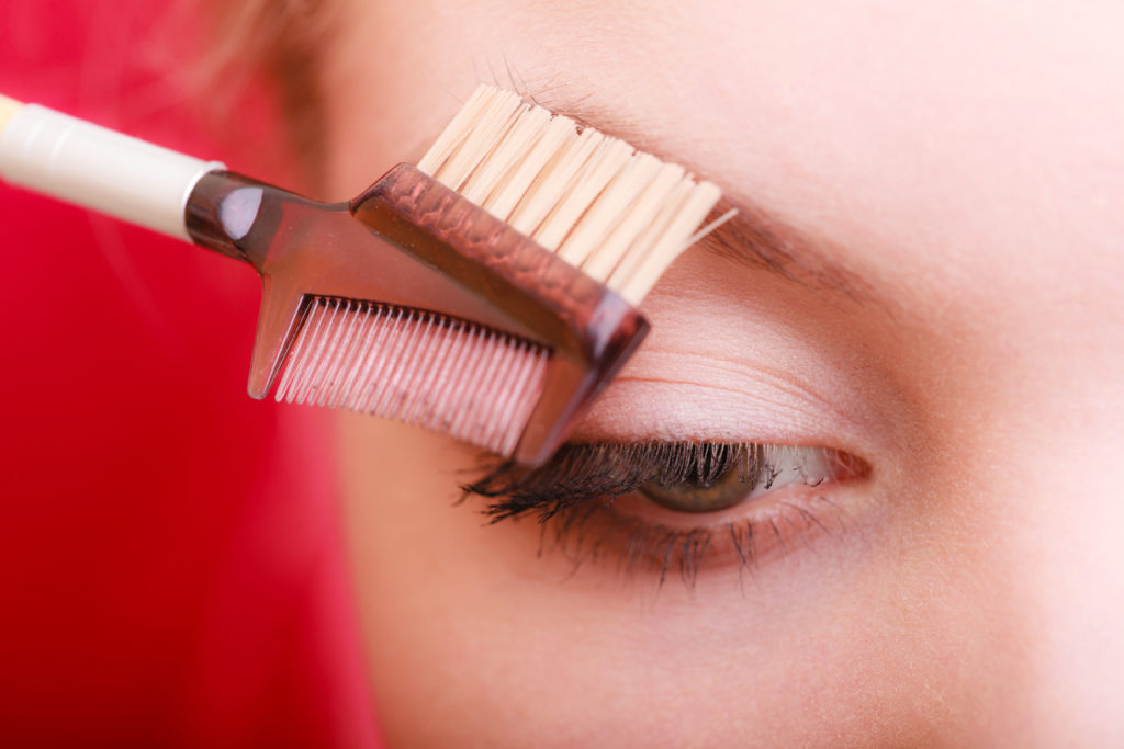 Closeup of woman using brush to give brows shape Pic: Istockphoto