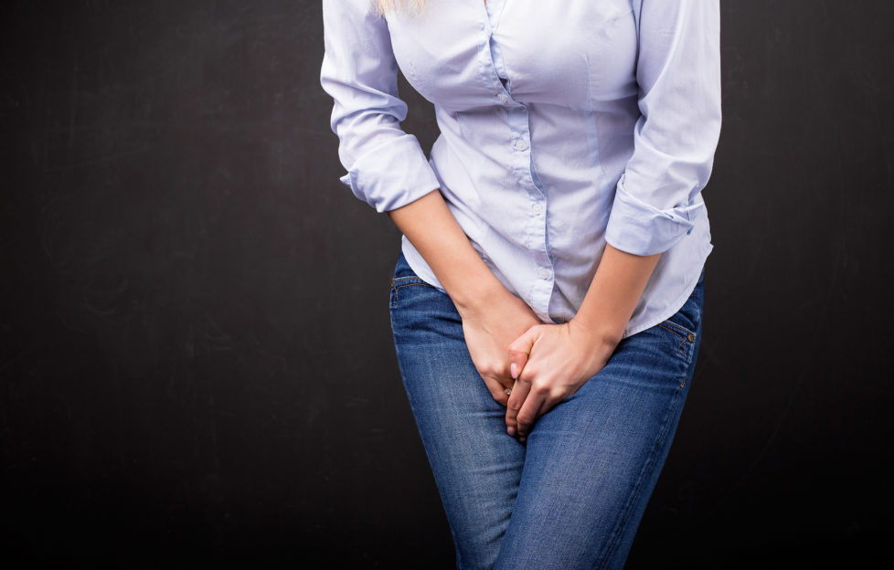 Woman in blue jeans dying for toilet