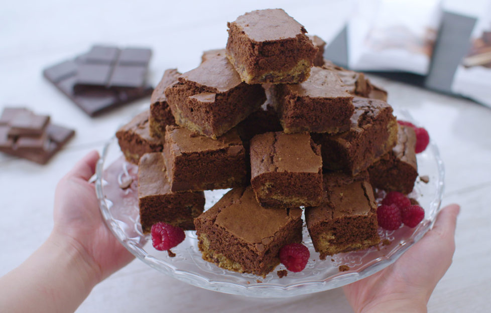 Pyramid of cut squares of two-layered chocolate brownie