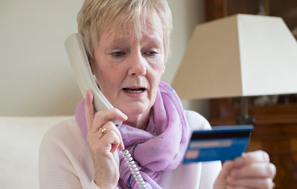 Lady giving credit card details over the phone Pic: Istockphoto