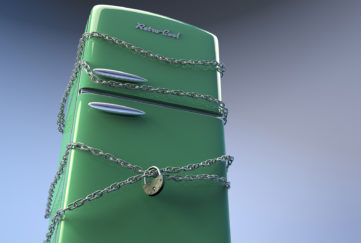 Chains and padlock on green fridge.