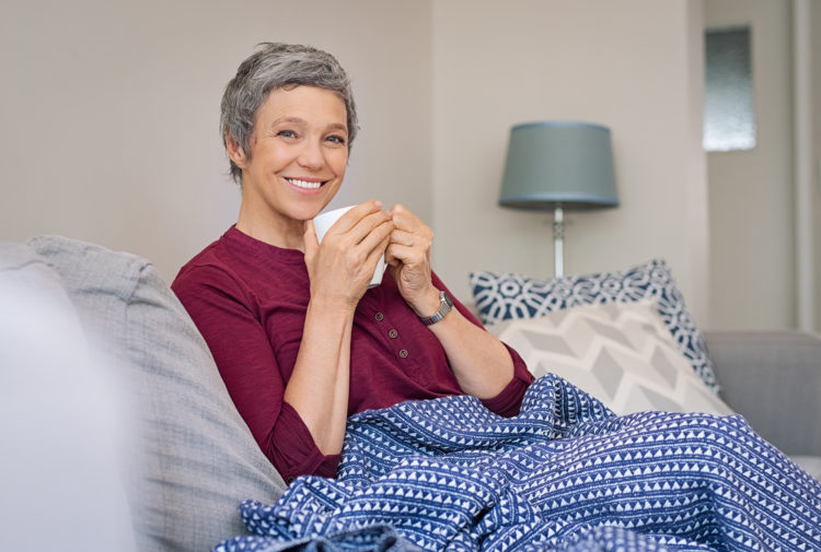Smiling senior woman drinking coffee