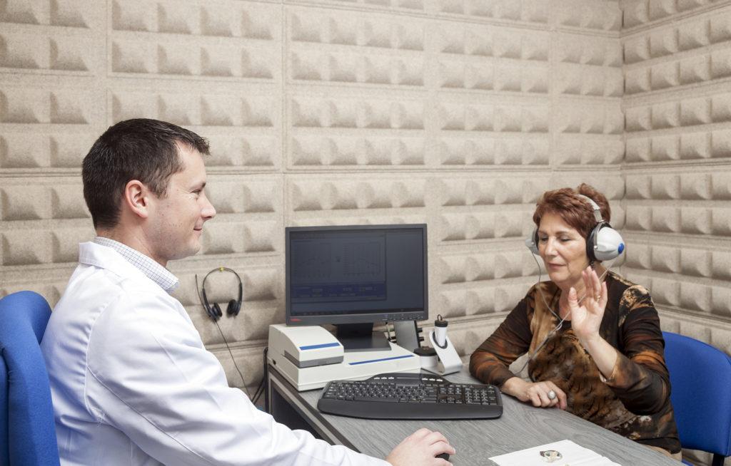 Woman having hearing check