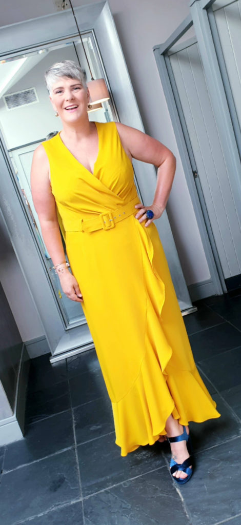 Lady in long yellow dress
