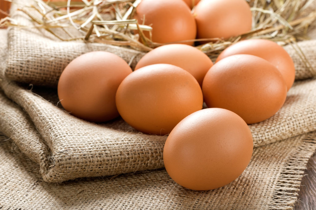 Eggs on sacking with straw in background