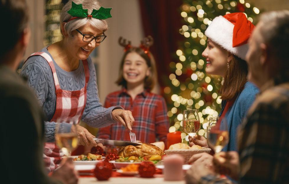Family having Christmas dinner at home.