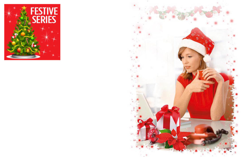 Woman in red dress and Santa hat, at desk with red phone and several wrapped gifts, staring glumly at computer screen