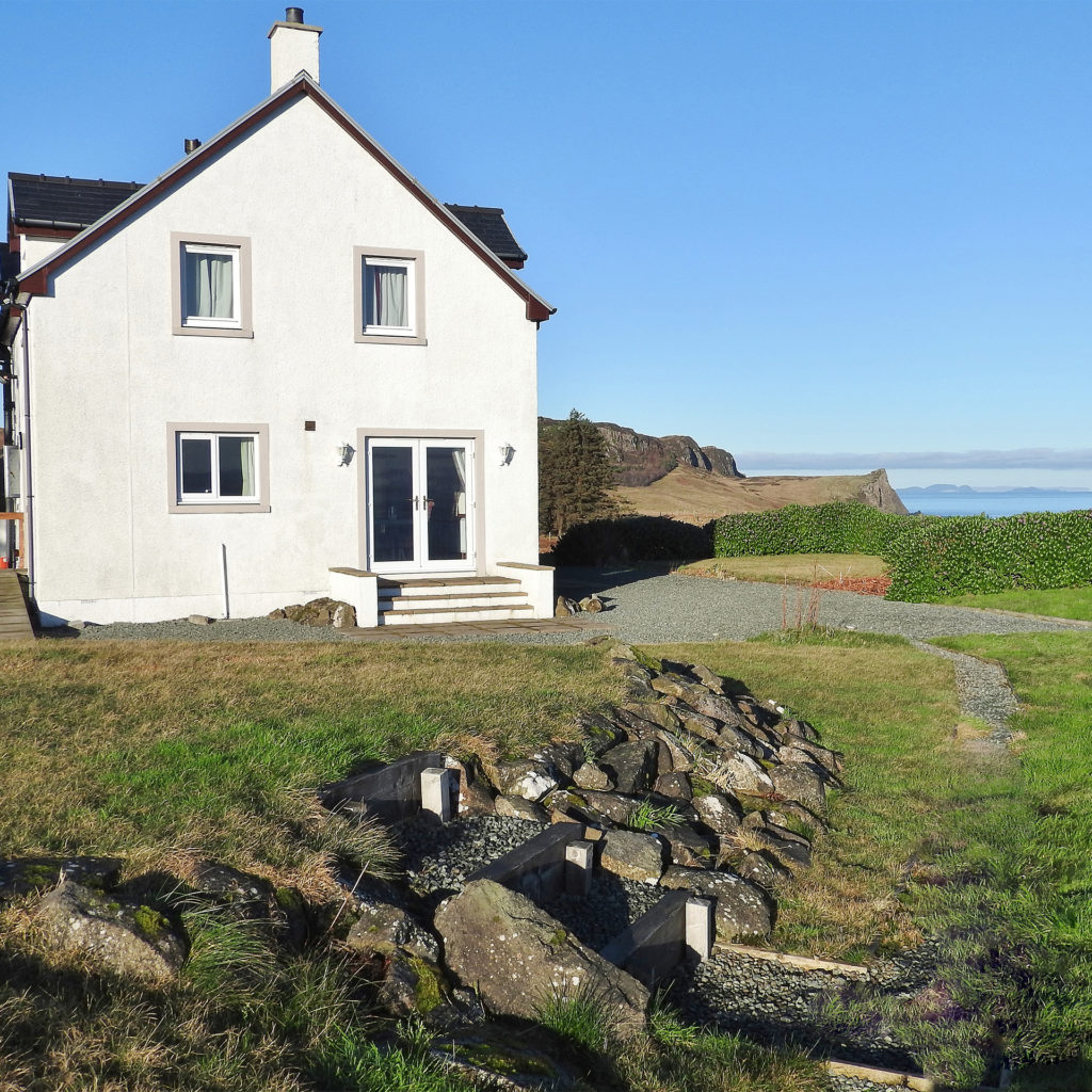 White painted cottage with double glazed windows, views out to sea